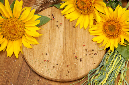 Summer background with sunflowers on vintage wooden board, copy space for text