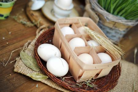 Hen eggs in basket, organic food concept