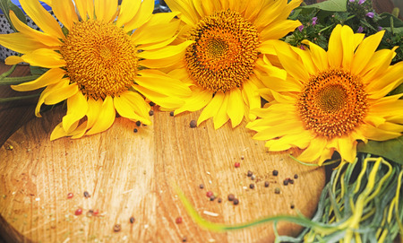 Background with sunflowers on vintage wooden board Stock Photo