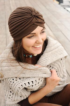 Beautiful smiling brunette woman portrait dressed in jersey turban