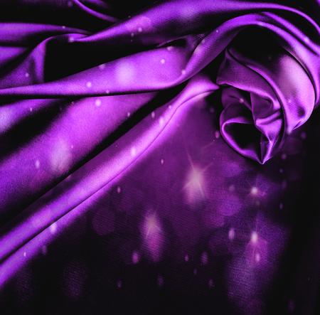Glare dark violet satin background.