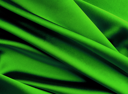 Green new year smooth silk background. Stock Photo