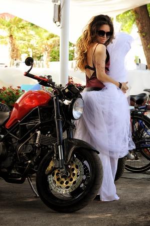 Bride woman with motorcycle, biker wedding Reklamní fotografie