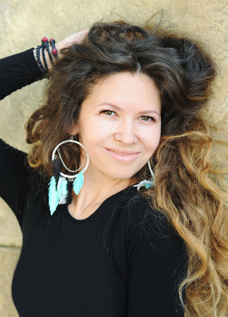 Beautiful woman portrait, long hairs, indie style, handmade jewelry, outdoors Stock Photo