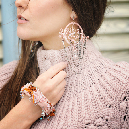 Young woman part of face close up, pink boho style dreamcatcher earrings Banque d'images - 120327884
