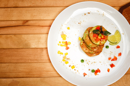 Squash fritters served on a plate, top view, outdoor cafe