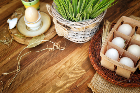 Organic raw chicken eggs in egg box against old style wooden background Stock Photo