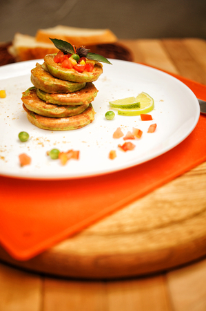 Vegetable pancakes on a plate, outdoor cafe