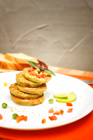 Vegetable fritters of zucchini, outdoor cafe Stock Photo