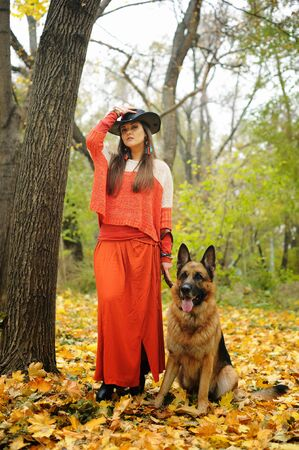 Woman portrait with her german shepherd dog, autumn outdoor Фото со стока - 129016298
