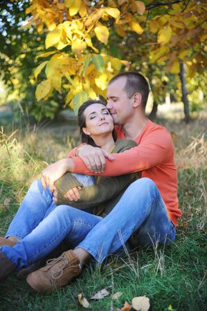 In love happy man and woman have a hugs and rest outdoor, family outdoor, husband and his wife embracing