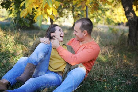 Young happy smiling man and woman rest outdoor, family relax, love couple have a time together