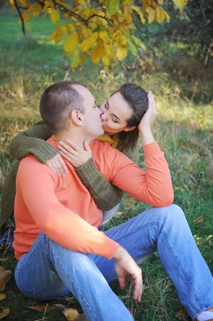 Young adult kissing love couple, have a rest outdoor, young family, honeymoon Фото со стока