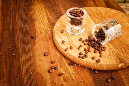 Close up coffee beans on vintage wooden background