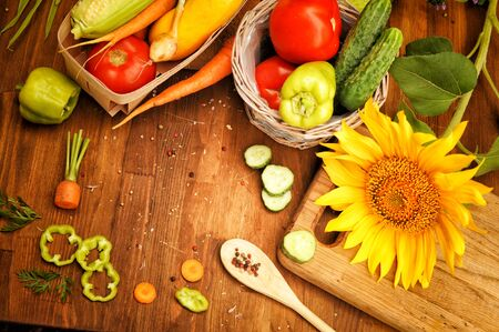 Fresh raw vegetables and spices on a wooden table, top view Фото со стока