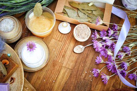 Hand made cosmetics backdrop with handmade artisan soap and cream