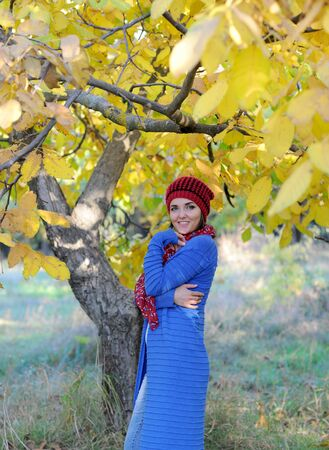 Young woman outdoor portrait, dressed in knitted beret and blue cardigan Фото со стока