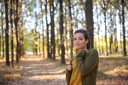 Young woman portrait in autumn park, casual wear, outdoor
