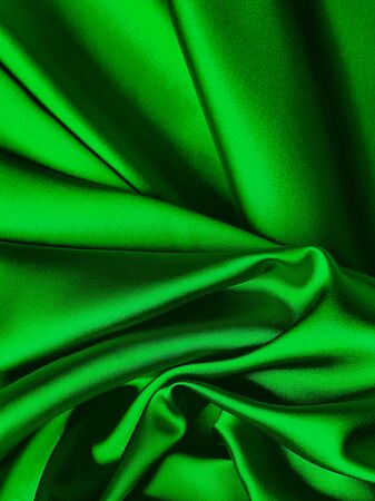 Green new year smooth silk background. Stockfoto