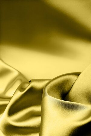 Luxury smooth golden silk background with place for text