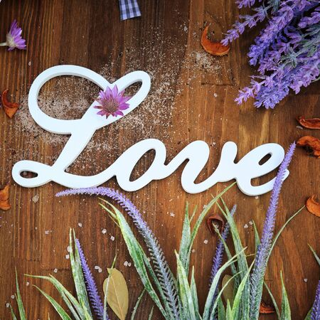 Love word card with retro wooden background and lavender flowers