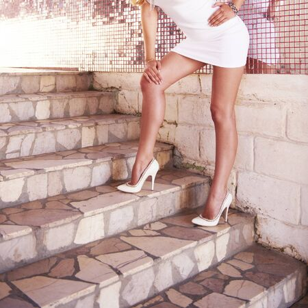 Sexy woman legs in luxury white high heel shoes Stockfoto