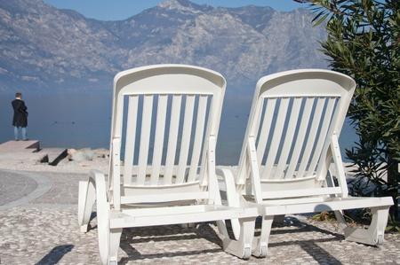 lake beach: Beautiful lake  beach with armchairs  Stock Photo