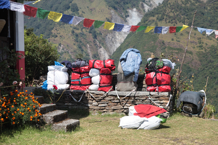 Backpacks on a track in the mountains of Nepal