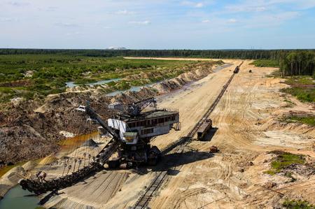 Top view at mine, railway, mining machinery. Horizontal shot