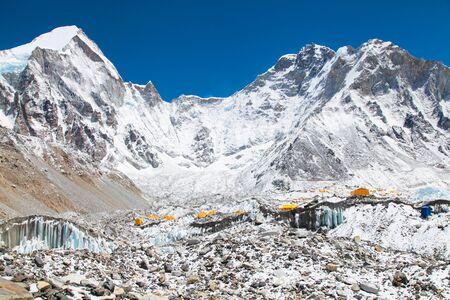 Bright yellow tents in Mount Everest base camp, Khumbu glacier and mountains, sagarmatha national park, trek to Everest base camp - Nepal Himalayas Stock Photo
