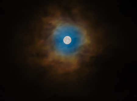 nebulous: Blurry soft and noise dramatic bright moon on cloudy Stock Photo