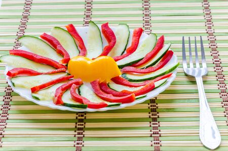 Sliced salad lined on a white plate