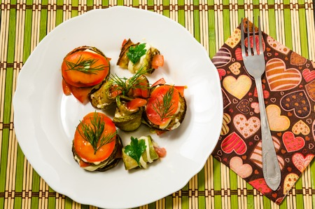 Cooked dish of courgettes and tomato with fresh herbs