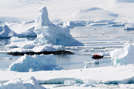 Antarctic Landscape with boat in water photo
