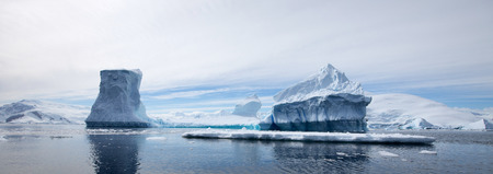 Antarctic Landscape with Reflections in the water photo