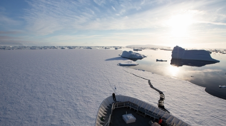Ship Breaking Sea Ice in Antarctica photo