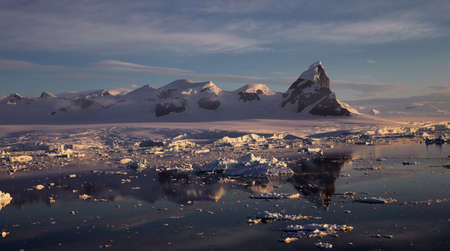 Antarctic Landscape with Iceberg Reflections photo