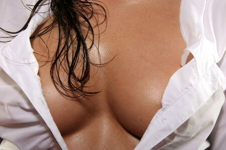 wet breast: breast of a young beautiful girl Stock Photo