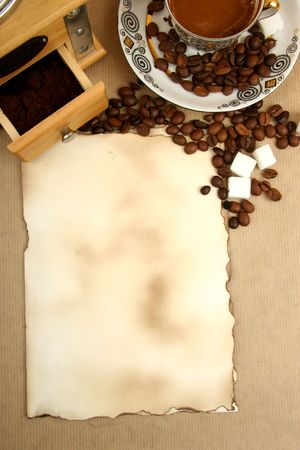 colombian food: coffee cup, mill and paper with spase for menu
