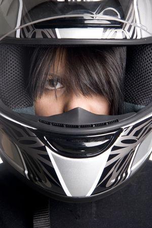 young attractive woman in big motorcycle helmet photo