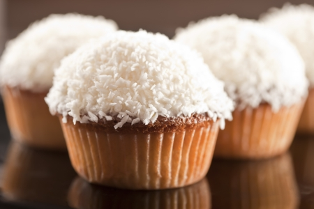 sugar paste: Sweet white cupcake with coconut and lemon Stock Photo