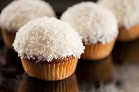cup cakes: Sweet white cupcake with coconut and lemon Stock Photo