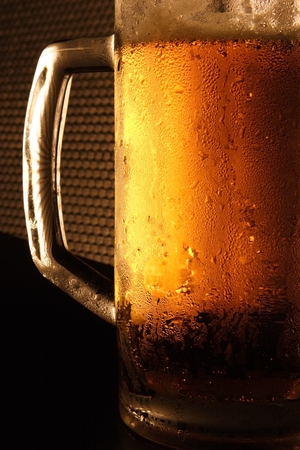 Mug with cold beer on a black background Stock Photo - 1685172