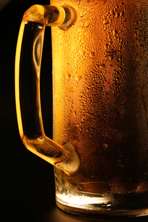 Mug with cold beer on a black background Stock Photo - 1685170