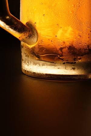 Mug with cold beer on a black background Stock Photo - 1686659