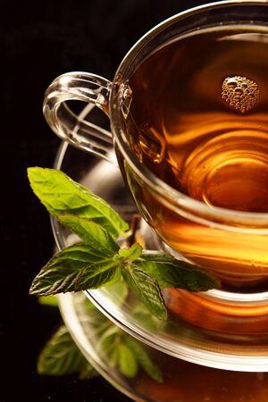Cup of tea black baground Standard-Bild