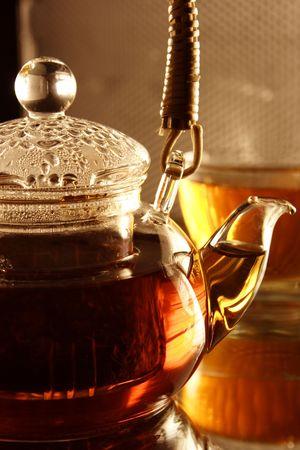 Tepot with fresh tea photo