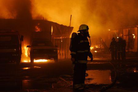 Firefighters in work Standard-Bild