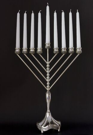 Traditional Hanukkah menorah on a black background photo