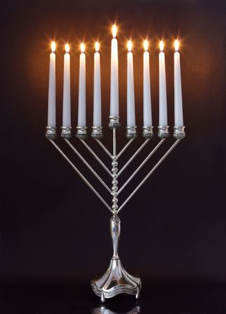 candlestick: Silver Hanukkah candles all candle lite on the traditional Hanukkah menorah